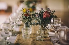 Who says your table needs to be overflowing with flowers?! Which, by the way, are insanely expensive! This bride kept the arrangements simple, and they look amazing! Head over to vsb for more wedding inspiration!