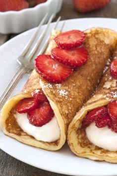 Gluten Free Strawberry Cheesecake Pancakes are full of protein and whole grains for a fantastic breakfast. You'll make them again and again! Click through for recipe!