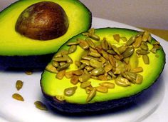 Salty Sunflower Avocado: Craving a salty snack? Skip the oily chips and fill half an avocado with salted sunflower seeds. The creamy texture and slightly sweet flavor of the avocado complements the salty crunch of the sunflower seeds beautifully. This snack is a little over 200 calories, so if you're looking for a lighter bite, enjoy one third of an avocado instead.