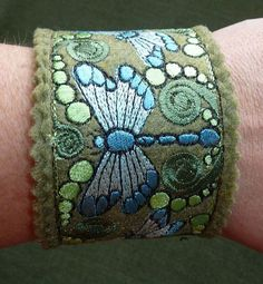 Items similar to Cuff Bracelet - Dragonfly & Fiddlehead - Embroidered - Recycled Felt Jewelry - Eco-Fi on Etsy Fabric Bracelets, Fabric Jewelry, Cuff Bracelets, Felt Diy, Felt Crafts, Cuff Jewelry, Diy Jewelry, Felt Embroidery, Leather Cuffs