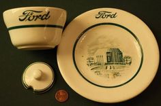 "1934 Chicago World's Fair Ford Motor Car Co.Rotunda Building plate & bowl-RARE!   Items are colorful white & green- 1) 6 1/4"" x 1"" tall sm saucer size plate -features gear shaped Ford Rotunda Building in the center & has the Ford motor car logo at top & w/ maker's mark: ""Shenango China USA"" on back. 2) 3 3/4"" wide x 2 1/4"" deep heavy fine china bowl w/ the ""Ford"" Motor Car company logo on front & Shenango Chinca company logo on the bottom   SOLD $47.51"
