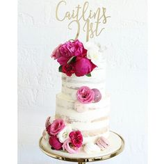 A fresh semi-frosted naked cake with fresh flowers and decadent macarons to celebrate a 21st in style  . Custom topper by @glisteningoccasions_