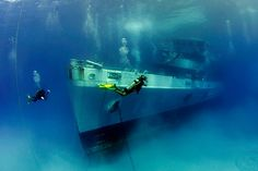The sunken wreck of the USS Kittiwake (Grand Cayman, Cayman Islands) | Following an illustrious half-century in service, this former navy ship was stripped of hazardous materials and sunk off the northern end of Seven Mile Beach in 2011. With marine growth on the Kittiwake (kittiwakecayman.com/about-kittiwake) still minimal, the fun is in exploring the 76.5m vessel – all five levels of her.