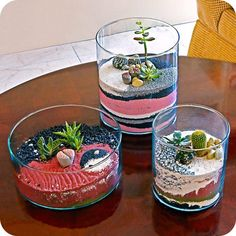 Terrariums are back in a big way! Love these with the colored sand and cactus.