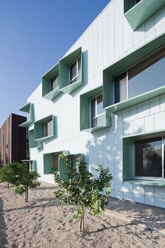 """The four buildings that make up this affordable housing development in Santa Monica, California, all feature mint-green solar shades on their facades, and are organised around a """"starfish-shaped"""" courtyard."""