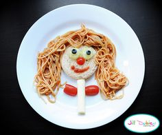 spaghetti lady - from meet the dubiens      Spaghetti lady: bread cut into a circle for face, cucumber and blueberry eyes, sliced cherry tomato nose, sauce lips, cheesestring body and cherry tomato arms (and yes, these are arms, lol!). The hair is of course spaghetti and sauce.