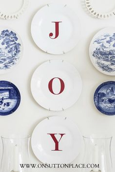 "DIY Dollar Tree JOY plates-these are perfect but I'm going to do it with the small ""silver"" trays from Dollar Tree. Maybe between windows above couch with small cedar wreaths from red gingham ribbon in front of the windows."