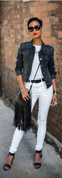 Black denim jacket, white t-shirt  & skinny jeans, black sandals & fringe shoulder bag