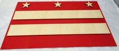 I make this 12x7 inch DC Flag in 8 colors for your home its cut plywood and recycled aluminum also so shown the reverse of the original piece that I make this no waste designs from