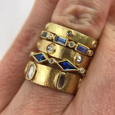 This 18k gold ring features light blue sapphire straight baguettes with round full cut diamonds accented with single milgrain. Pictured in: 18k yellow gold .54ctw blue sapphire baguette .05ctw white diamond 1.5mm Jennifer Dawes Design curates the most beautiful collection of diamond and precious gemstones available for all of our designs. Many of our stones are one of a kind and if a particular piece has sold, we will source gemstones in similar shape, size and color. Due to fluctuations in…