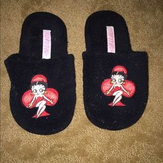 Fuzzy Betty Boop Slippers ☺️ Super cute Betty Boop slippers, received as a gift. Unfortunately not my size. These are a size Medium but fits 5-7.5! Traction bottom with no signs of ware. Authentic Betty Boop. Very squishy and comfortable to walk in. No piling on them just lint ☺️ will be cleaned before shipped. NWOT -  (W/ out box)   (W/ out tags) (I always ship within 1 business day) RETAIL: $40.00 I  THE OFFER BUTTON! NO PP, TRADES, OTHER APPS, ALL PICTURES ARE MINE Betty Boop Shoes…