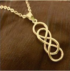 Revenge Emily Thorne gold tone Double infinity necklace- Brand new