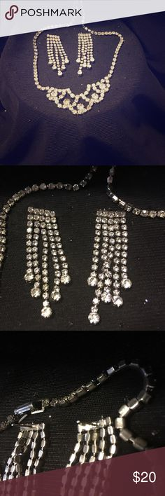 """Stunning 2 PC Jewelry Rhinestone Necklace Earrings THIS IS A PRE LOVED VINTAGE 2 PC BUNDLE FROM THE LATE 80's EARLY 90's. IN EXCELLENT CONDITION. Stunning & Very Elegant style SILVER Rhinestone Necklace & EARRINGS. NECKLACE IS 16"""" & HAS a folder over clasp as closure. The earrings are post studs 5 different lengths on them 2"""" in length almost .5"""" across (you will have to provide your own backs to the post of earrings. Feel sexy feel elegant feel the world as you wear this set out on the…"""
