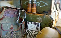 "Vintage safari gear & a copy of ""I Married Adventure"""