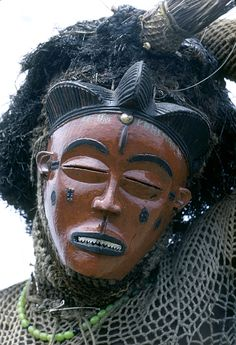 Pwo mask dancer, near Gungu, Congo (Democratic Republic).Photo taken by Eliot Elisofon in 1971.  Relates to Female (Pwo) mask. Chokwe peoples (Democratic Republic of the Congo). Late 19th to early 20th century C.E. Wood, fiber, pigment, and metal.