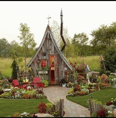 This garden shed is unlike anything we've ever seen! Dan Pauly designed this unusual shed, with its distinctively crooked chimney and… shed design shed diy shed ideas shed organization shed plans Fairy Houses, Play Houses, Garden Cottage, Home And Garden, She Sheds, Shed Plans, Little Houses, Dream Garden, Outdoor Gardens