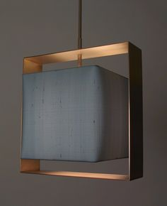 Halo Box Pendant designed by Chad Jacobs of Bone Simple Design. Shade: Shown with silk box shade and satin brass 'Halo' frame *Other fabrics and colors to choose from *Shade can be made with stripes or 'faceted' pattern