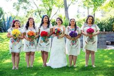LOVE the bridesmaids with different colored bouquets