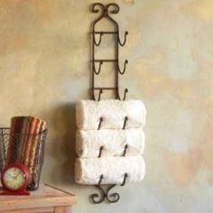 Wine racks as towel holder. Decorative space saver!