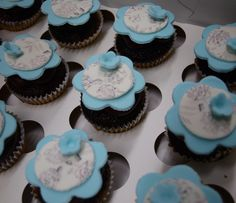 black and white print cupcakes with baby blue flowers