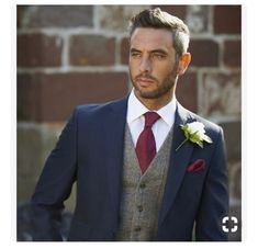 This is the groom colour tie (ivory waistcoat, pinstriped navy suit). We like this flower style too.