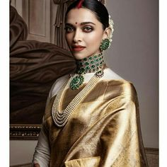 To make it easier for you, we have the top trending beautiful silk saree blouse designs so that you can choose the best for your saree look. Indian Bridal Outfits, Indian Bridal Fashion, Indian Fashion Dresses, Indian Designer Outfits, Lehenga, Sabyasachi, Deepika Padukone Saree, Golden Saree, Bandeau Outfit