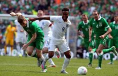 Republic of Ireland's defender Seamus Coleman (L) vies with England's midfielder Raheem Sterling during the international friendly football match between Republic of Ireland and England at Aviva Stadium in Dublin on June 7, 2015. The game finished 0-0.