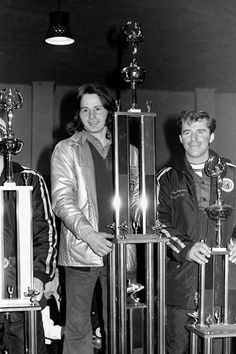 Long-haired Gilles Villeneuve brings home the hardware from the 1973 USSA snowmobile races held at the Milwaukee Mile. Villeneuve's Mod-III Alouette took top honors in-class. Also shown is Arctic Cat factory driver Dave Thompson.