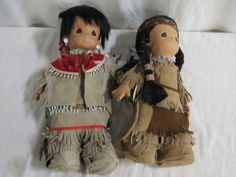 Precious Moments Little Indian Dolls, Boy has a bow and Girl (Morning Star) gas a Papous for her baby. Their Outfits are real leather and their both complete just as they were bought new. 16 Dolls with the original tags attached. These dolls are in perfect condition and cute as can be.  Perfect Valentines Day Gift. Trending Price for this set is $200.0 for set