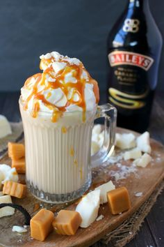 If you're a fan of Rum Chata or Bailey's, you're gonna LOVE this Spiked White Hot Chocolate! Homemade hot chocolate made with just a few simple ingredients, along with your choice of your favorite creamy liqueur! Topped with whipped cream, white chocolate chunks and caramel this cocktail is decadent and delicious!