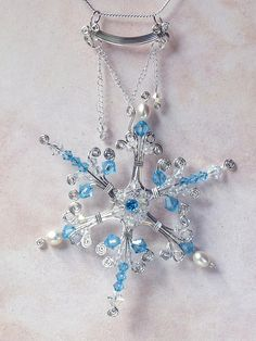 "Amazing wire wrapped snowflake award-winning pendant. Handmade in blue topaz, crystal, pearl and sterling silver. This is a large piece, approx. 3"" x 4""  It will arrive on a solid stainless steel chain in gift box or pouch.  $325. Free US shipping."