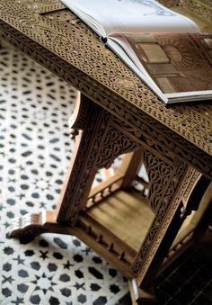 Hand sculpted Moroccan wooden table. #Moroccan #Wood #Art.