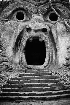Explore the Parco dei Mostri (Park of the Monsters), in Bomarzo, Italy. It's a great day trip from Rome, walking in the lush gardens among some scary, and some funny, giant statues. Here, you can walk into the giant's mouth!