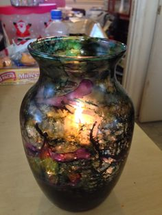 Alcohol inks on glass vase with vase filler glass rocks and candle