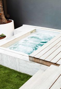 ground flooring Bright idea: The outdoor space was designed by Think Outside Gardens and includes a spa pool by Concept Pools Australia that hides away under retractable decking, offering more space when needed for entertaining. Jacuzzi Outdoor, Outdoor Baths, Small Spa, Courtyard Pool, Small Courtyards, Small Backyard Pools, Spa Design, Ground Floor, Outdoor Spaces