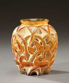 A blown-moulded orange tinted vase, model «Chamois». Acid-etched «R.Lalique France». Model created on the 27th July 1931.