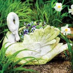 This beautifully crafted swan planter has two functions. It houses greenery and flowers, and doubles as yard art.