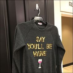 Wine aficionados will appreciate the phrase, while fixture buffs enjoy finding a Command Strip in retail use as a Say You'll Be Wine T-Shirt Pin-Up Hook Shirt Pins, T Shirt, Command Strips, Hooks, Pin Up, Retail, Graphic Sweatshirt, Wine, Sayings