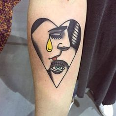 Conventional heart shaped illustrative tattoo on the right inner forearm.