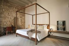 Mercer Hotel Barcelona by Rafael Moneo 18 - I love the canopy bed in this bedroom.