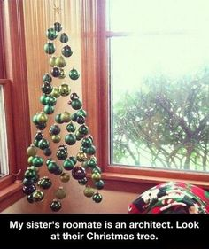 Make you own Christmas Tree with a box of ornaments and fishing line.