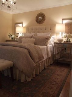Restful beige bedroom with mirrored night tables and tufted fabric headboard. Id love to get 2 side mirrors and hang them just like this in your room. We can use one if the 2 round mirrors we already bought above your bed.