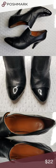 Calvin Klein Black Heel Booties Size 9.5 Calvin Klein Black Heeled Booties Heel height: 4 inches Size 9.5 Good used condition. There are signs of wear on the heels and soles of shoes. Please see pictures. Very beautiful shoes. Would be perfect for a professional office setting Calvin Klein Shoes Heels