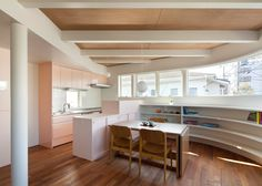 Naf Architect & Design creates Tokyo house with a curving wall