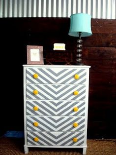 If i ever got a dresser, i would want to paint it like this. A different color though.