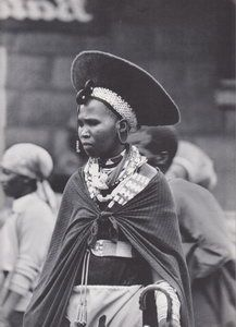 Zulu woman wearing a flaring Zulu human hair hat, reminiscent of the hairstyle of her ancestors.