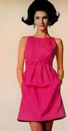 Benedetta Barzini modelling a pink dress 1960's