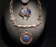 A personal favorite from my Etsy shop https://www.etsy.com/listing/248414471/copper-jewelry-set-lapis-lazuli-jewelry