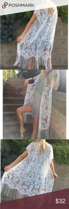 White lace fringe kimono Our white lace kimono adds a boho touch to every outfit, slip it on over a bikini, or your favorite summer dress for an effortlessly chic vibe.  Content + Care  hand wash cold 100% poly Size + Fit  ones size fits all Other