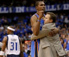 Oklahoma City's Kevin Durant (35) celebrates with coach Scott Brooks beside Dallas' Jason Terry (31) during Game 4 of the first round in the...
